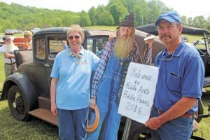Karen Simmering and Mike McIntosh pose with a cutout of Popcorn Sutton. (Erwin Record Staff Photo by Curtis Carden)