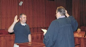Todd Wilcox, left, takes the oath of office in front of Judge David Shults on Tuesday, July 26. Wilcox was appointed to the Unicoi County Commission by the panel on Monday to complete the unexpired term of Walter Garland. Garland passed away in late May. (Erwin Record Staff Photo by Brad Hicks)
