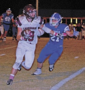 Blue Devil Dylon Burgess chases Johnson County's Gage Hampton during the Blue Devils' 28-14 victory on Friday, Oct. 28, at Gentry Stadium. UCHS will go on the road to face Alcoa on Friday, Nov. 4. (Erwin Record Staff Photo by Keeli Parkey)