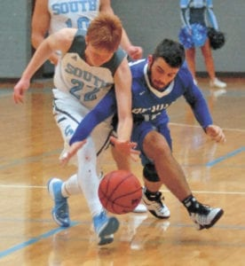 Dylan Putman fights for a loose ball with a Sullivan South player last week. Putman scored 15 points in the 55-48 victory. Last week saw the Blue Devils fall to Science Hill and defeat South before beating Cloudland on Monday, Dec. 5. (Erwin Record Staff Photo by Keeli Parkey)