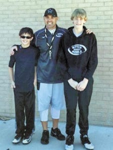 UCMS eighth grade football players Colton Roberts, left, and Dylan Adams recently competed for coach Ryan Witten and the Witten Huddle program. (Contributed photo)
