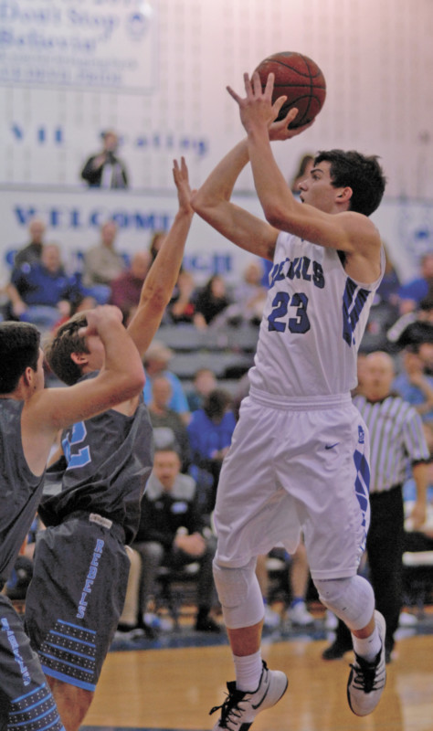 Trevor Hensley takes a shot against Sullivan South on Friday, Jan. 20, at UCHS. Hensley's 3-point play, with 14 seconds left in the game, lifted the Blue Devils to a 56-55 victory. (Erwin Record Staff Photo by Keeli Parkey)