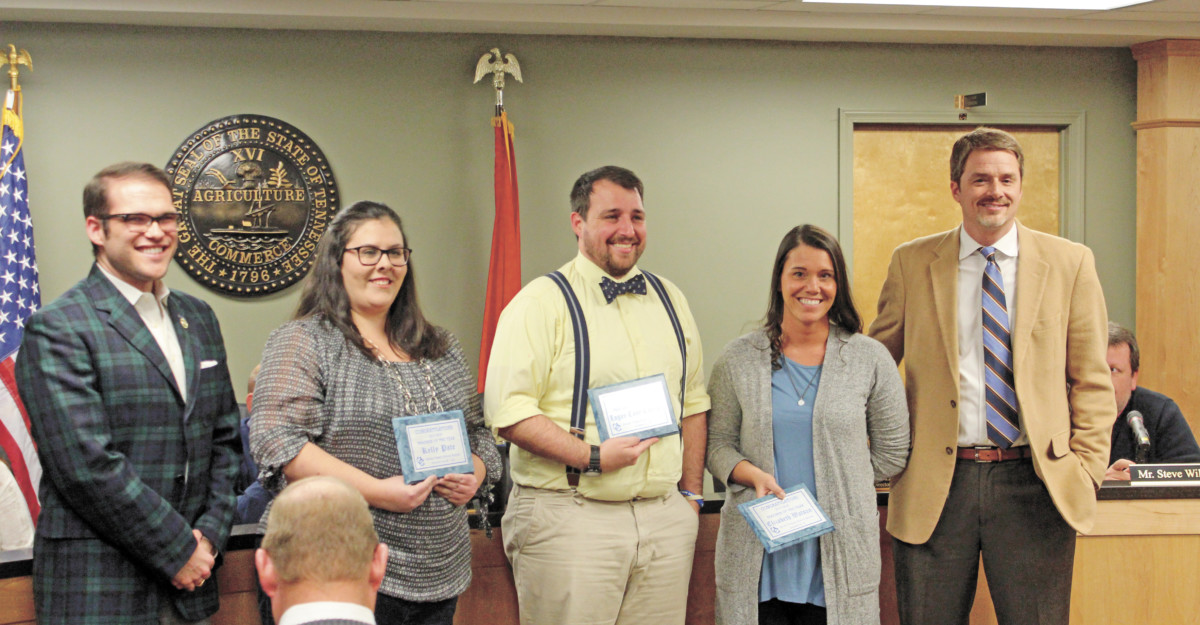 """Pictured, from left, are UC School Board Chairman Tyler Engle, teachers of the year Kelly Pate, Logan """"Cane"""" Cannon and Elizabeth Watson and Director of Schools John English. The teachers were recognized for their honor. (Erwin Record Staff Photo by Brad Hicks)"""