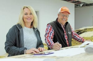 Luann Hendren and contractor Doug Bowman look over blueprints for the remodel of her building at 724 Ohio Ave. Once completed, the facility will again be home to the  Tennessee Department of Human Services as well as provide an office space for the Tennessee Highway Patrol. (Erwin Record Staff Photo by Brad Hicks)