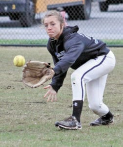Faith Bailey fields a ball in right field. (Erwin Record Staff Photo by Keeli Parkey)
