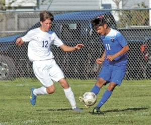 Leroy Valdez takes a shot on goal during a recent UCHS soccer game. (Erwin Record File Photo)