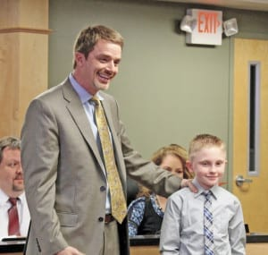 Director of Schools John English introduces Jacob McKinney during the Unicoi County Board of Education meeting on Thursday, March 10. McKinney was honored by the board for saving his cousin from a house fire. (Erwin Record Staff Photo by Keeli Parkey)